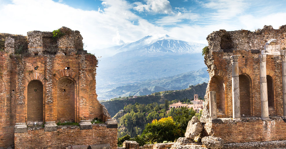 Taormina - Mt Etna seen thru columns of the Greek theatre ruins