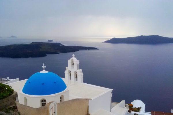 Santorini - famous blue-domed church of St. Gerasimos in Fira