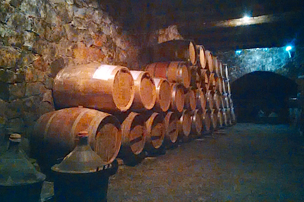oak barrels in the wine cellar at Dourakis winery